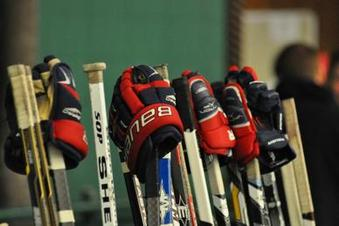 hockey gloves and sticks